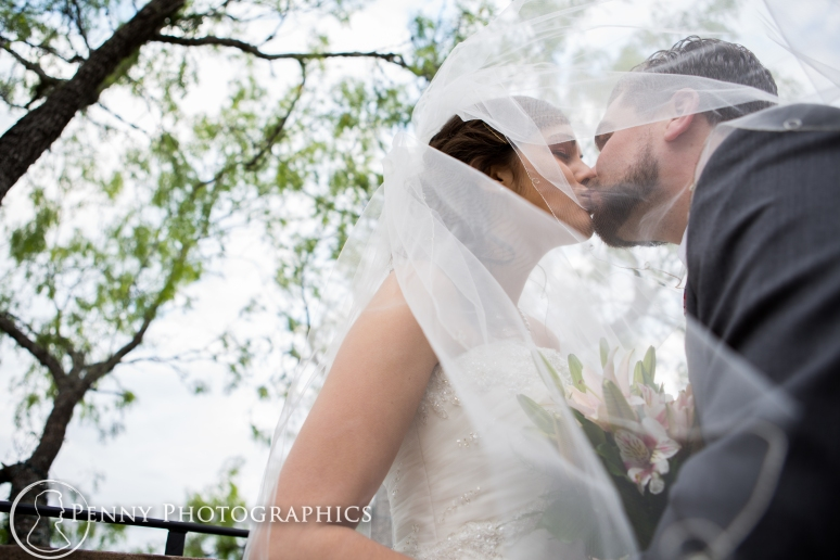 Romantic Wedding photo kiss under veil at TerrAdorna in Manor, TX