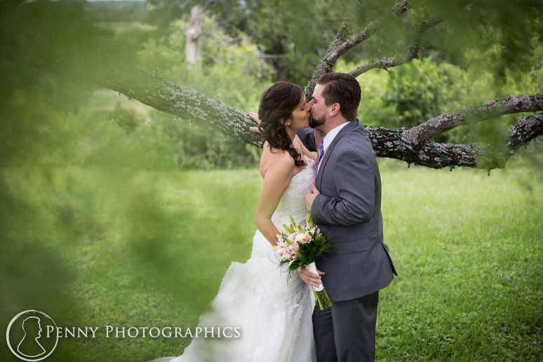 Wedding photos under tree at TerrAdorna in Manor, TX