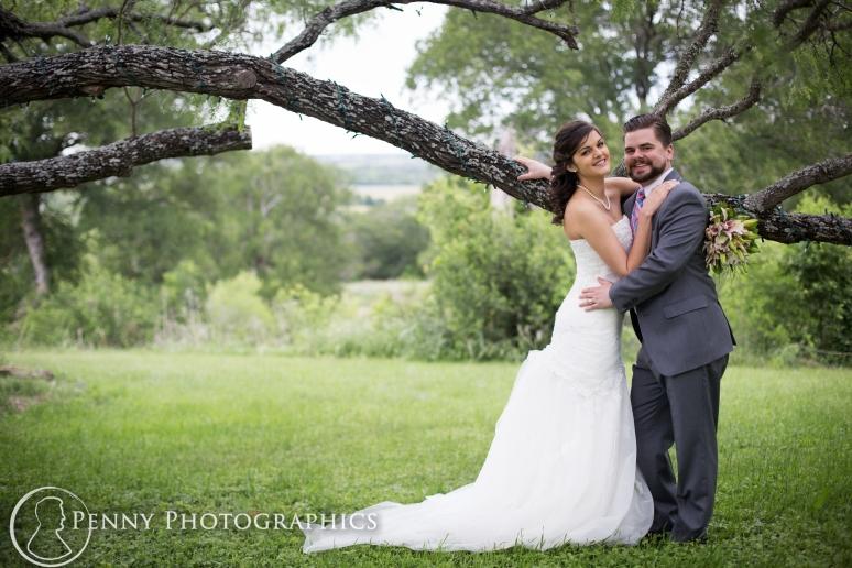 Wedding photos under tree at TerrAdorna in Manor, TX