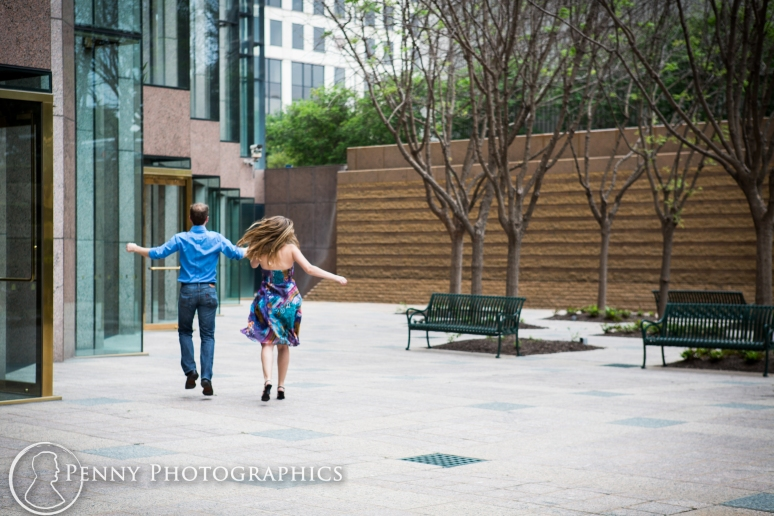 fun portraits in courtyard by building