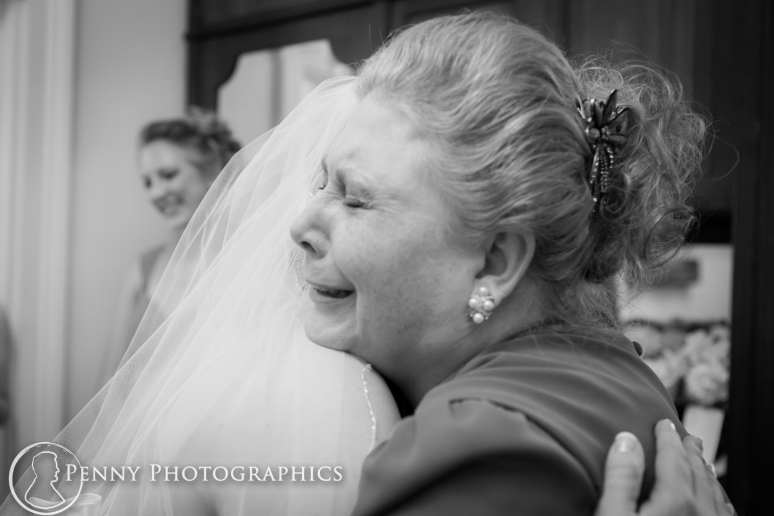 Mom and bride hugging before wedding at Allan house in Austin, TX