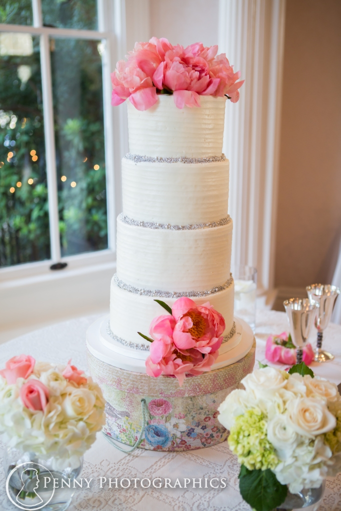 Pink flower wedding cake from bluenote bakery at Allan house in Austin, TX