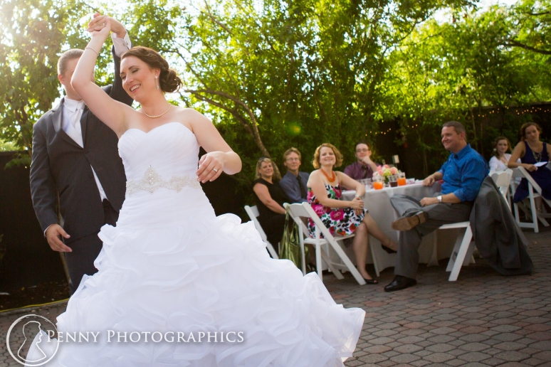 Couples first dance spin outdoor at Allan house in Austin, TX