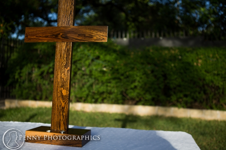 Wooden cross for wedding casting shadow at Allan house in Austin, TX