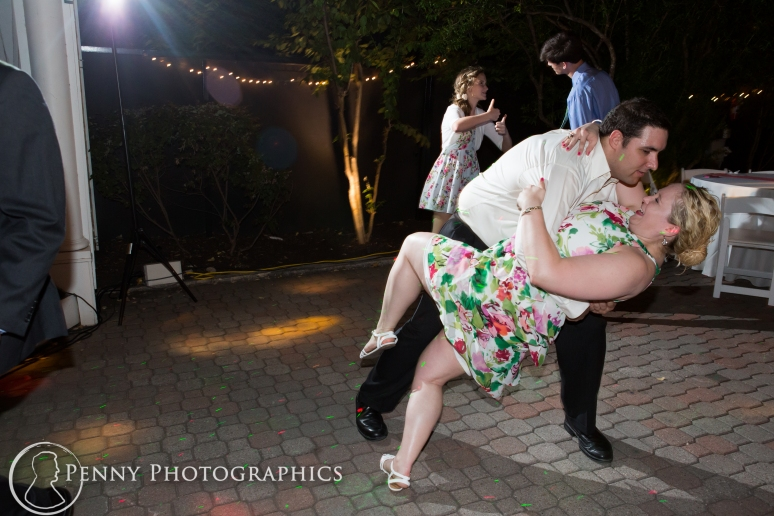Dancing dip move at outdoor wedding reception at the Allan house in Austin, TX