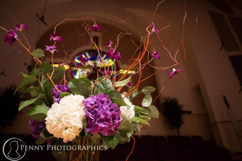 Purple flower arrangements church wedding