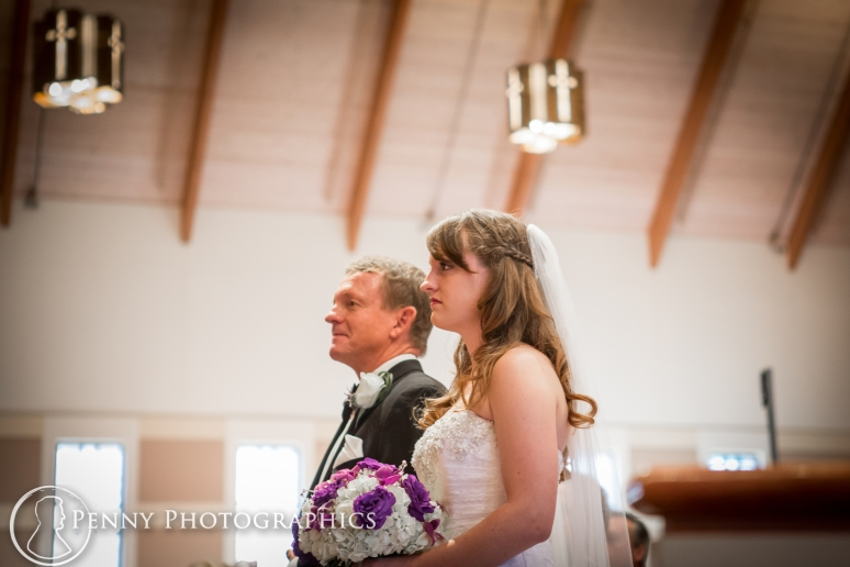 bride and father down the isle