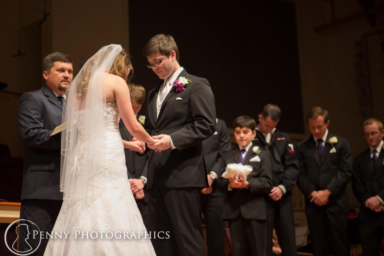 bride and groom praying at wedding
