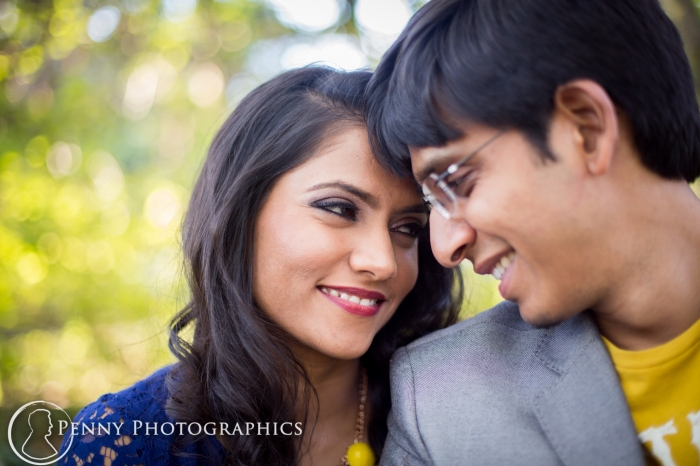 couple cuddling during engagement phtoos