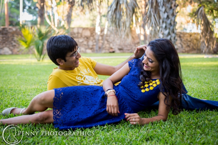 engagement photos outside on the lawn