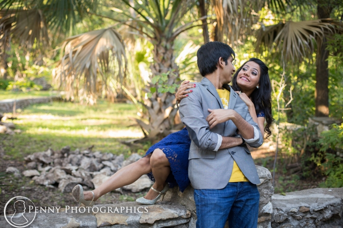 couple having fun during engagement session at Mayfield park