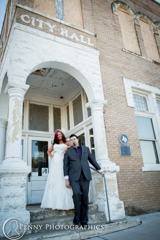 bride and groom in front of courthouse