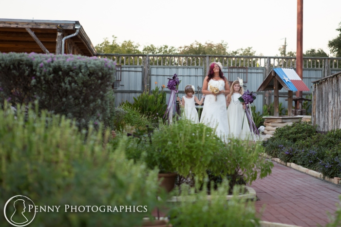 Bride and daughters walking down isle
