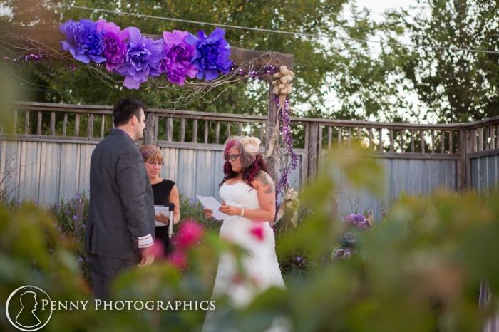 bride reading vows at ceremony