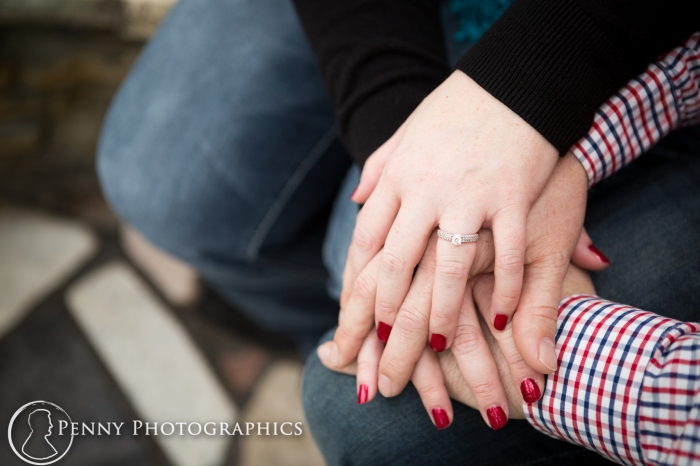 Showing off engagement ring during engagement session