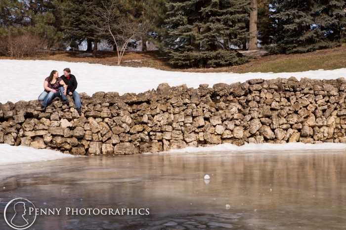 sitting on rocks by a frozen lake