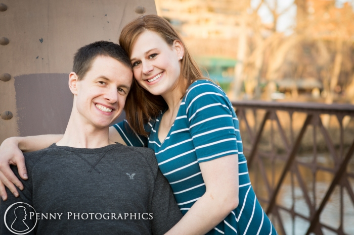 Couple on bridge by Mill District MN