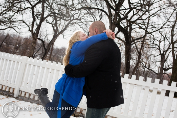 having fun during engagement session at Minnehaha park