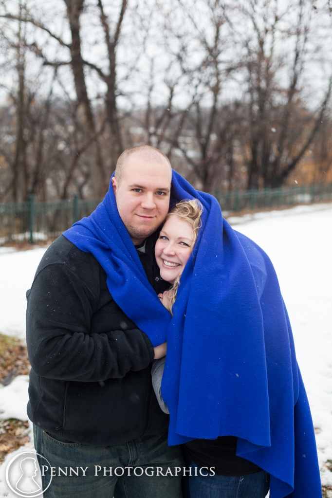 photos under blanket during winter engagement session