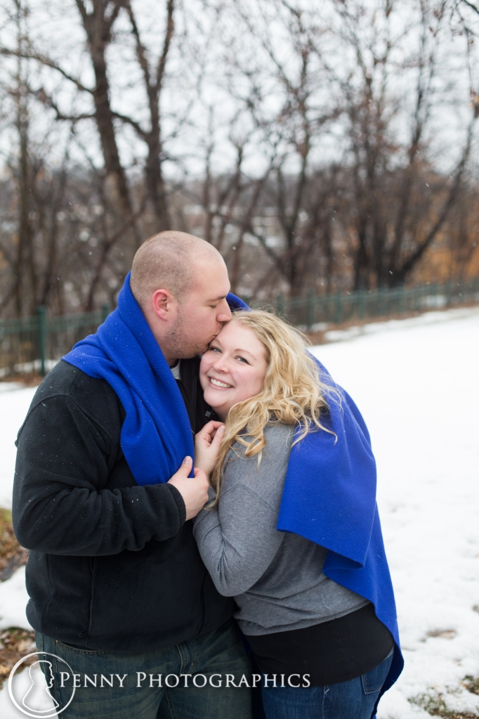photos with blanket during engagement session MN