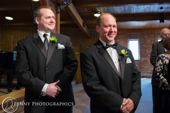 groom sees bride walking down the isle