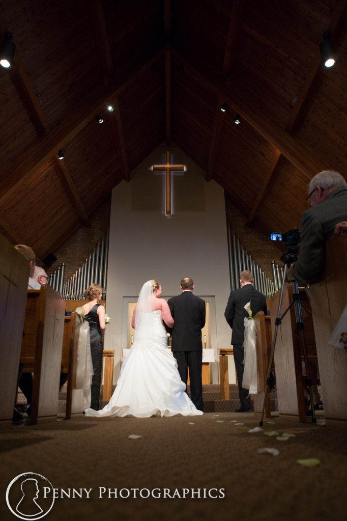 standing at the alter in church MN wedding