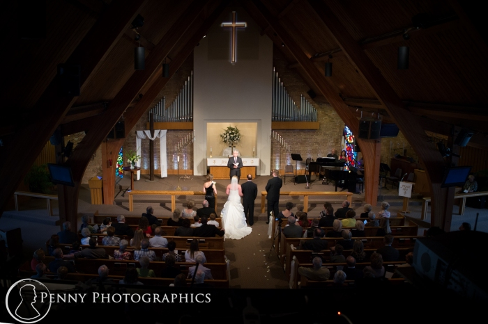 Bride and groom at the alter in Church wedding MN