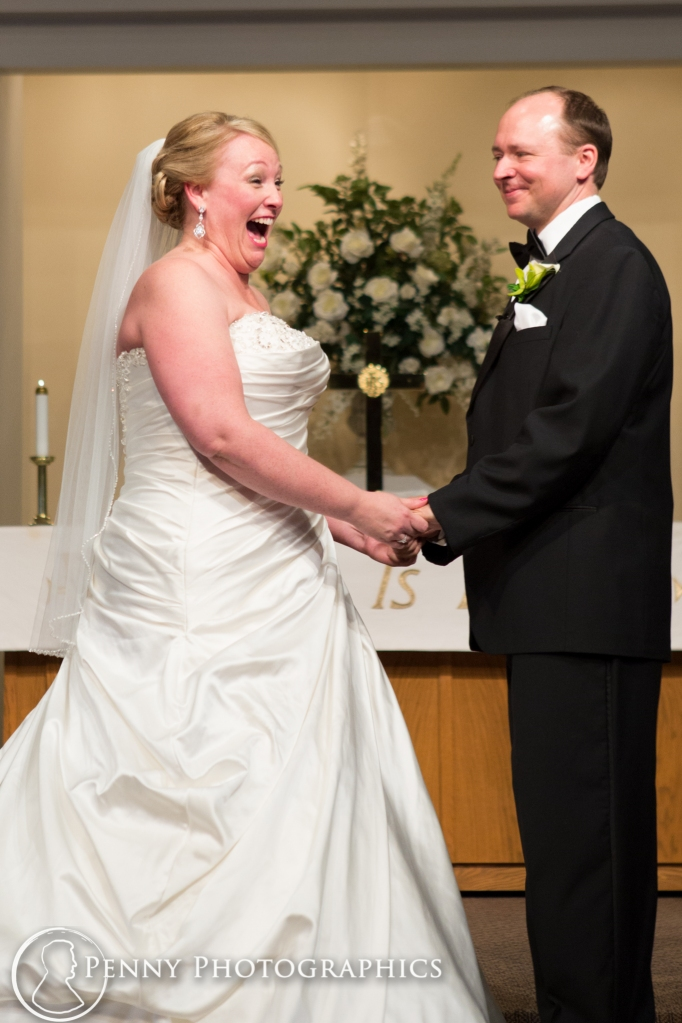 excited bride during ceremony at church wedding MN