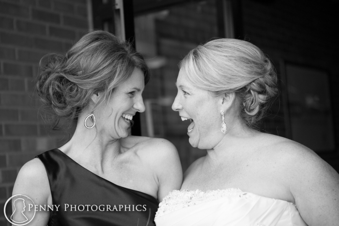 bride and best friend laughing