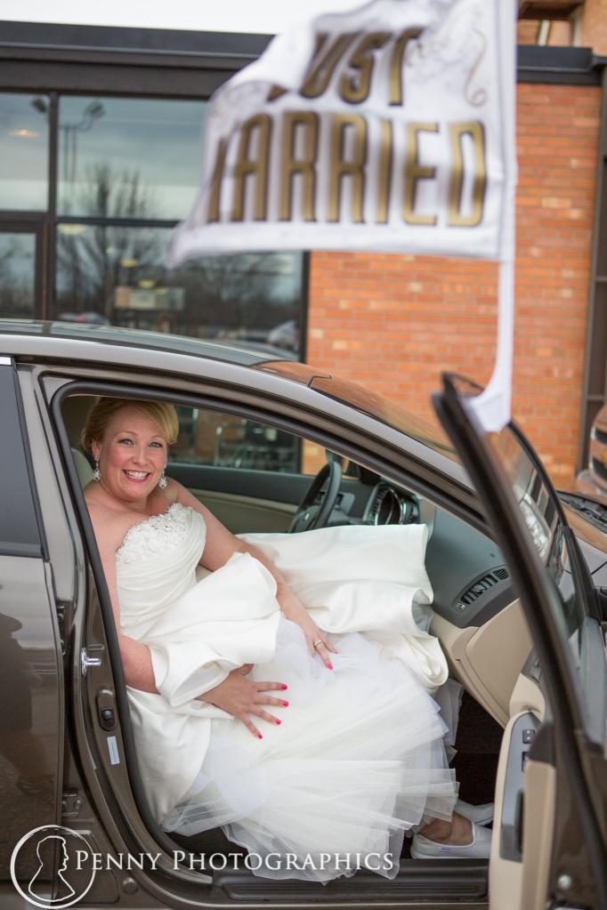 bride in the exit car