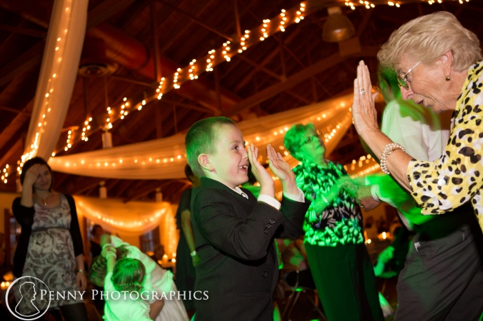Kid and grandma dancing at the reception at Earle Brown Center MN