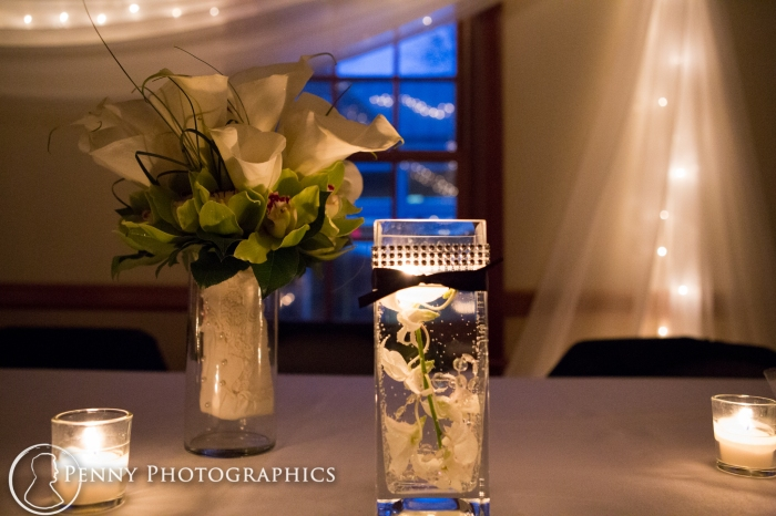 The flowers and table setting at wedding