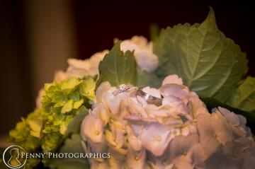Wedding ring photo on flowers MN