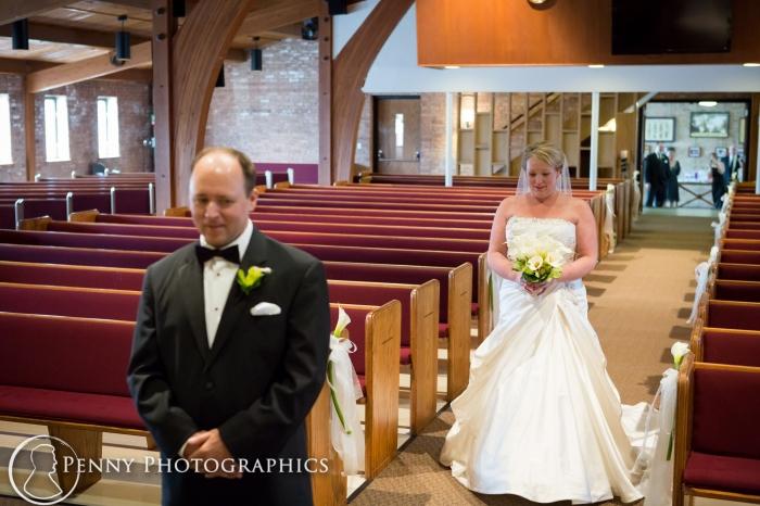 bride walking to meet groom at the first look