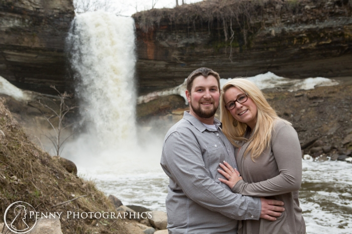 Couple standing by the falls in Minnehaha falls park MN