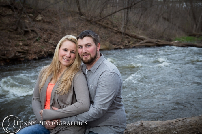 couple by the river bank in Minnehaha falls MN