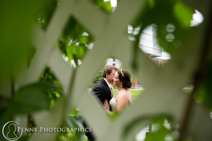 romantic wedding portrait through lattice in Minneapolis