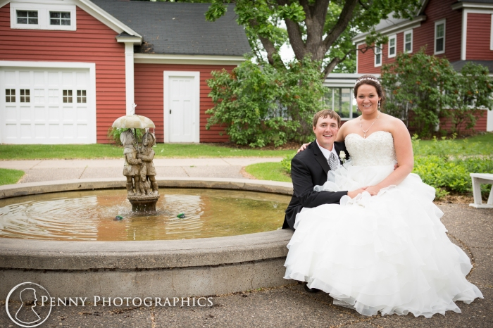 couple portraits outdoors by fountain at Earle Brown Minneapolis