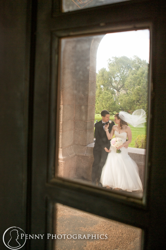bride and groom through window at wedding in Minneapolis