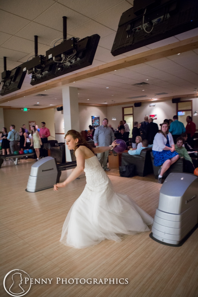 bride in wedding dress bowling at pinstripes in Minnesota