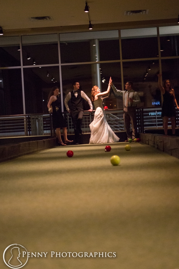 wedding party playing bocci ball during wedding reception at Pinstripes MInneapolis