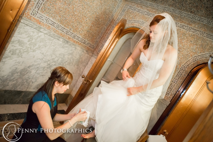 maid of honor putting on brides shoe