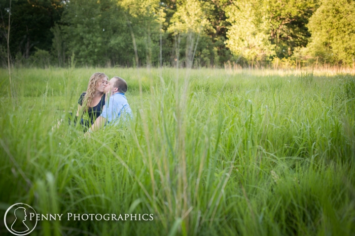 couple portraits outside in a field