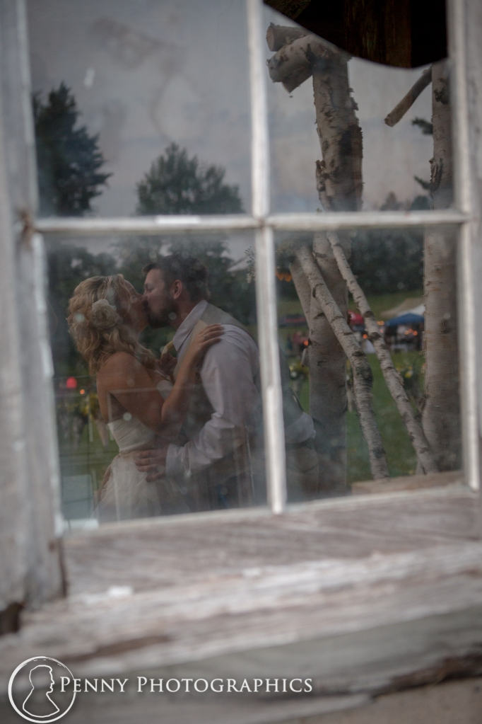 Couple reflection in barn window- Minnesota