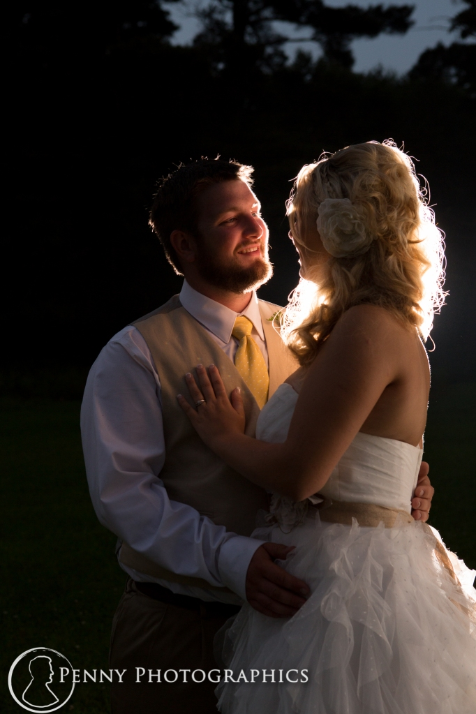 bride and groom at night by Penny Photographics