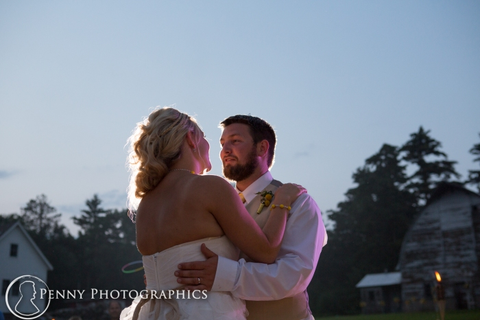 bride and groom dancing at twilight