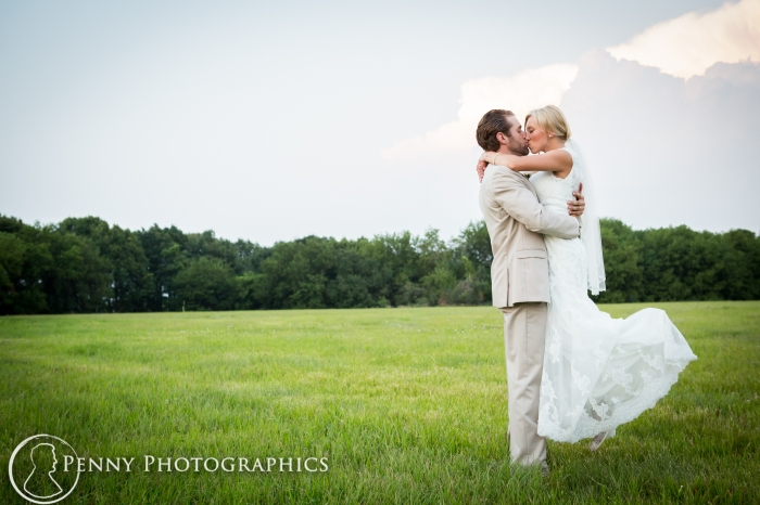 groom-swinging-bride-in-field