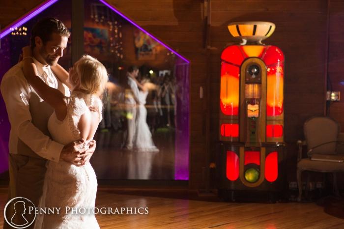 bride-groom-dance-reflection-barn