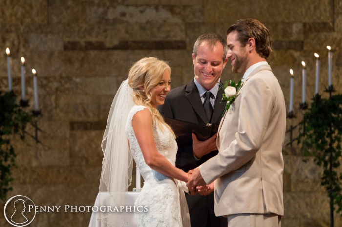 bride-laughing-at-alter