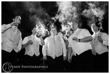 Men during wedding reception smoking cigars